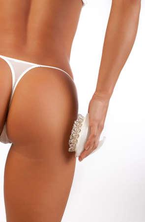 belles jambes: Photo de crosse de fille sexy belle isol� sur blanc Banque d'images