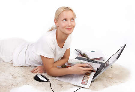Portrait of attractive women resting on fell and reading magazine photo