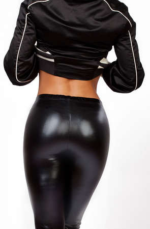 Part of body of woman in leather pants from behind Stock Photo - 5700356
