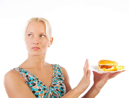 Portrait of woman refusing to eat unhealthy fast food photo