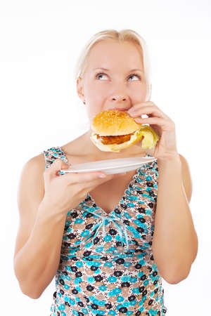 Portrait of hungry sexy girl eating hamburger photo