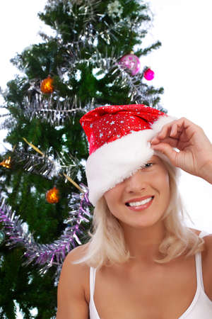 Portrait of playful young blonde near christmas tree photo