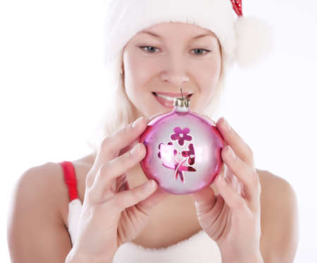 Portrait of sexy santa blonde holding a beautiful toy in her hands photo