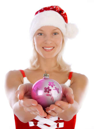Portrait of sexy santa girl holding a toy in her hands photo