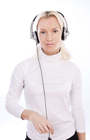 Portrait of attractive blonde listening music and smiling Stock Photo - 5827920