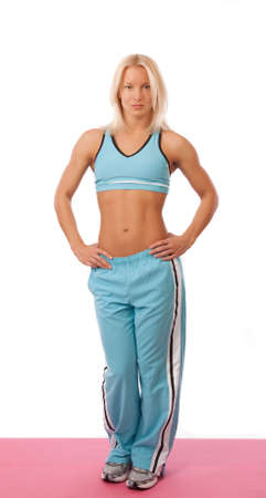 Beautiful blond girl with athletic body photo