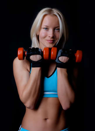 Happy smiling sexy blonde doing exercise photo