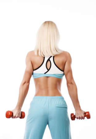 Portrait of a sportswoman holding dumbbells  photo