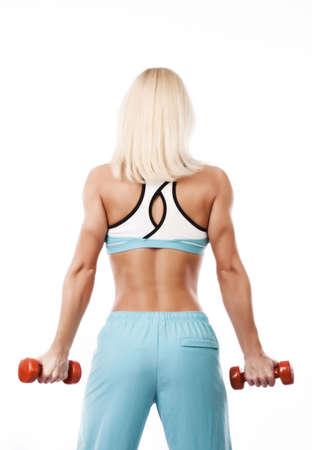 Portrait of a sportswoman holding dumbbells  photo