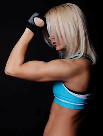 female muscle: Portrait of sexy blond sportswoman resting during training