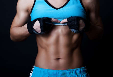 Portrait of athlete with muscular torso