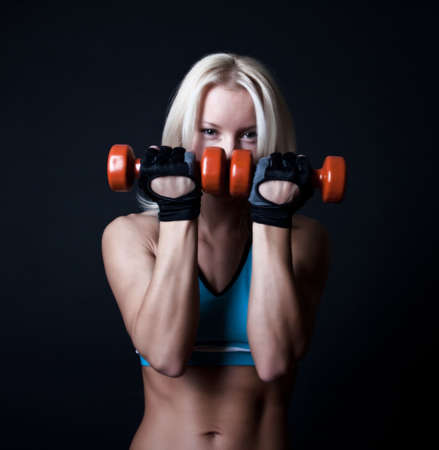 Tired blonde doing exercise photo