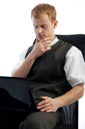 workday: Concentrated businessman working with laptop