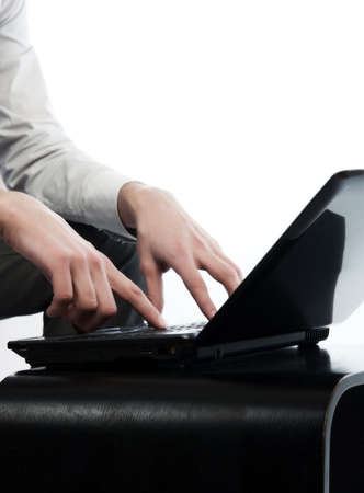 Close-up portrait of a mans hands working on computer photo