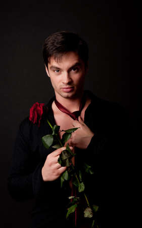 Picture of attractive male holding red rose photo