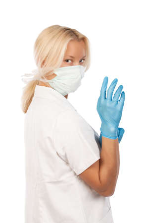 medical gloves: Woman doctor standing isolated over white background  Stock Photo