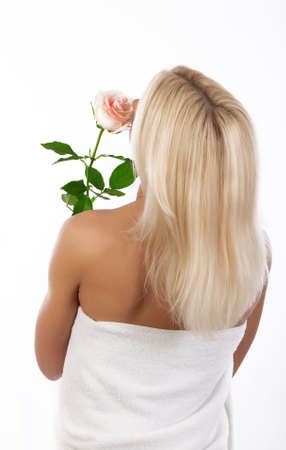 essences: Picture of back of blond girl holding rose