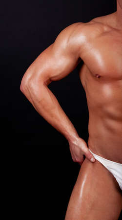 muscular male: Muscular man covering isolated on black