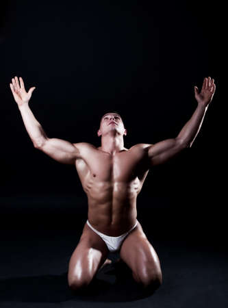 male underwear: Picture of athlete on his knees Stock Photo