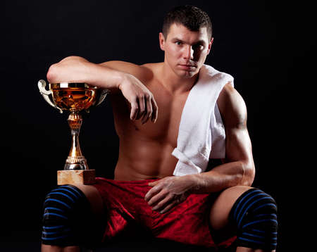 Picture of champion holding his cup photo