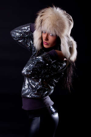 Picture of attractive serious girl wearing fur hat photo