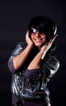 Sexy smiling female listening music and smiling photo