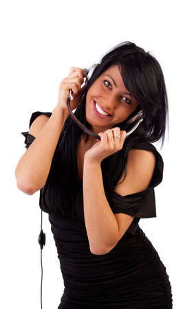 Sexy young woman holding headphones and smiling photo