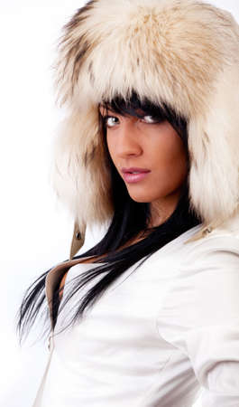 Playful look of sexy girl  wearing fur hat photo