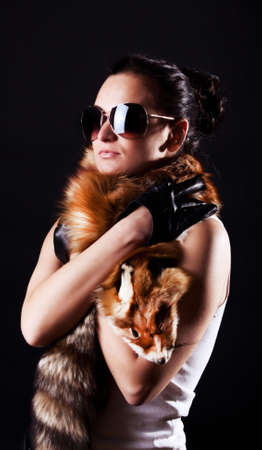 Portrait of styish woman wearing holding  fox skin photo
