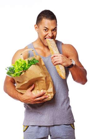 Portrait of sexy man eatig bread in studio Stock Photo - 17719571