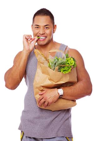 Portrait of handsome man eating salad Stock Photo - 17719592