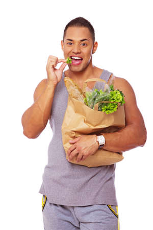 Portrait of sexy man posing in studio with salad Stock Photo - 17719591