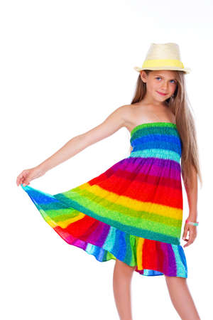 Portrait of beautiful girl posing in studio in hat