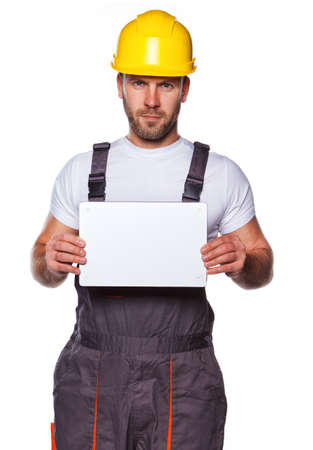 Image of standing enginer holding white paper Stock Photo