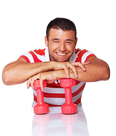 Portrait of sport trainer posing in gym with dumbbells photo