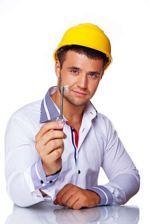 Portrait of smiling engineer posing in studio with key from house Stock Photo - 17752867
