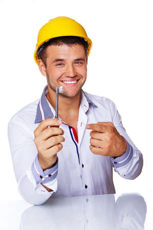 Portrait of smiling engineer posing in studio with key from house Stock Photo - 17752866