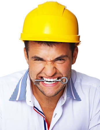 Portrait of crazy engineer eating key from house Stock Photo - 17752876