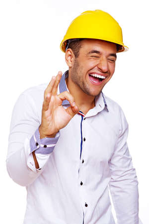 Portrait of smiling engineer posing in studio in helmet Stock Photo - 17752875
