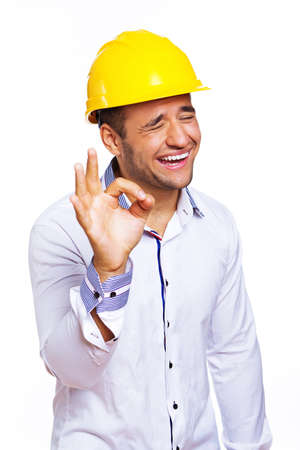 Portrait of smiling engineer posing in studio in helmet Stock Photo - 17752859