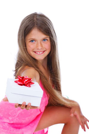 Portrait of young girl posing in studio with a gift photo