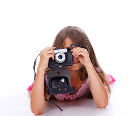 Portrait of beautiful girl posing in studio with camera photo