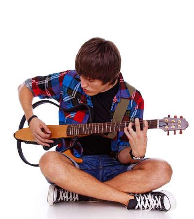 Portrait of rock artist posint in studio with guitar