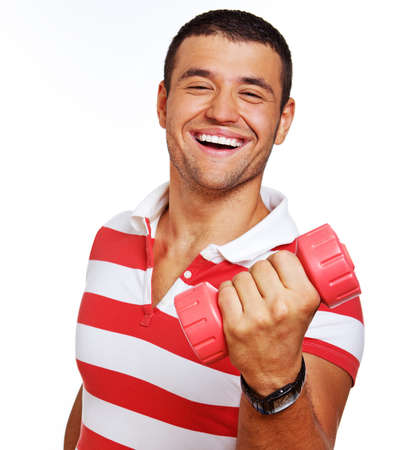 Portrait of young trainer posing in studio with dumbbells photo