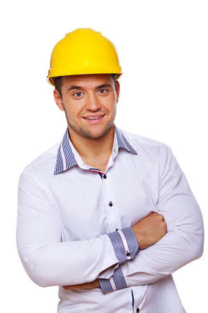 Portrait of handsome engineer posing in studio in helmet photo