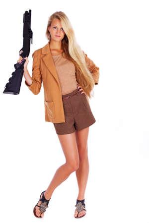 Portrait of sexy girl posing in studio with gun Stock Photo
