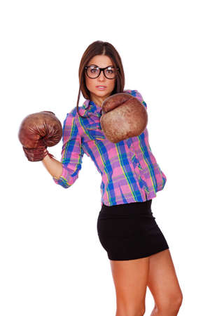 A young girl with glasses is boxing photo