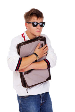 Portrait of sereous man posing in studio with bag Stock Photo - 17981393