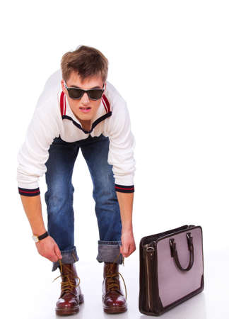 Portrait of sereous man posing in studio with bag Stock Photo - 17981390