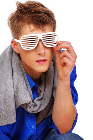 sleazy: Portrait of fashion man posing in studio in glasses